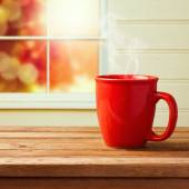 Red cup over window — Stock Photo