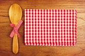 Tablecloth and wooden spoon for cooking anf baking — Stock Photo