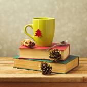 Tea mug on books — Stock Photo