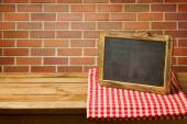 Chalkboard on checked tablecloth — Foto Stock