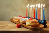 Menorah and donuts for Hanukkah — Stock Photo