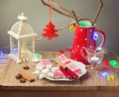 Table with plate and Christmas decorations — Stock Photo