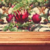Table over Christmas tree decorations — Stock Photo