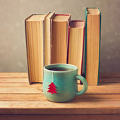 Tea cup and old books — Foto de Stock
