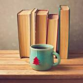 Tea cup and old books — Stok fotoğraf