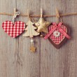 Christmas ornaments hanging on string — Stock Photo #55295319