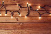 Empty table and Christmas lights — Stock fotografie