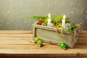 Box with Christmas decorations and candles — 图库照片