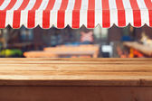 Wooden table with awning — Foto de Stock