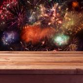 Table over fireworks background — Stock Photo
