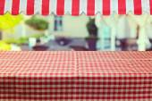Table with tablecloth and awing — Foto Stock