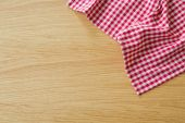 Checked tablecloth on wooden table — Stock Photo