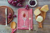 Wine, cheese and grapes on table — Stock Photo