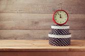 Gift boxes and watch on wooden table — Стоковое фото