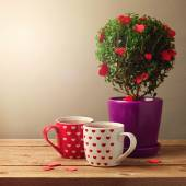 Cups and tree plant with heart shapes — Fotografia Stock