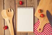 Notepad with cooking utensil — Stock Photo