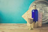 Matzo and wine on wooden vintage table — Stock Photo