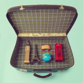 Suitcase and souvenirs — Stock Photo