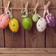 Eggs decorations hanging on rope — Stock Photo #68665599