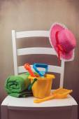 White chair with childs play items — Stock Photo
