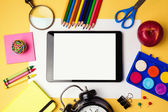 Tablet and school supplies — Stock Photo