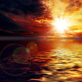 Sun and  sky  reflection  in water — Stock Photo