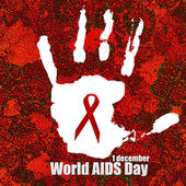 AIDS red ribbon sign in hand print — Stock Photo