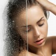 Beautiful girl washes her head behind a weeping glass shower door — Stock Photo #60480869
