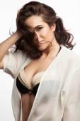 Happy woman in a bikini with a white background — Stockfoto