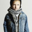 Fashionable little boy in scarf and jeans.winter style.fashion kids.child in black cap — Stock Photo #54084135