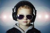 Little deejay. funny boy in sunglasses and headphones.child listening music. dj — Stock Photo