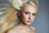 Young beautiful woman with long hair. Sexy blond girl. Beauty salon haircare. Wallpaper — Stock Photo