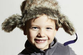 Smiling child in fur Hat.Kids casual winter style.fashion little funny boy.children emotion.hat ear flaps — Stock Photo