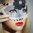 Beautiful Blond Young Woman in Carnival Mask.Masquerade. Beauty Girl with red lips. Manicure — Stock Photo #60880947