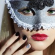 Beautiful Blond Young Woman in Carnival Mask.Masquerade. Beauty Girl with red lips. Manicure — Stock Photo #60880953