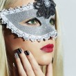 Beautiful Blond Young Woman in Carnival Mask.Masquerade. Beauty Girl with red lips. Manicure — Stock Photo #60880963