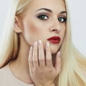 Young Blond woman with manicure.Beautiful model with make-up — Stock Photo