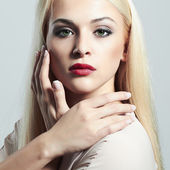 Young Blond woman with manicure.Beautiful girl model with make-up — Stock Photo