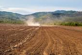 Plowing Tractor on Agricultural Field — Stock Photo