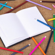 Colored pencils and notebook — Stock Photo #52423261