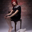 Red-haired girl with doll in a gloomy atmosphere — Stock Photo #69591105