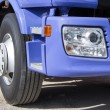 Blue truck with big wheels — Stock Photo #70644257