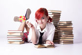 The girl in anime style with candy and books — Stock Photo