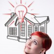Red-haired girl dreams of your own home — Stock Photo #75350461