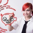Red-haired girl paints pig piggy bank — Stock Photo #75547093