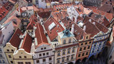 Row houses with traditional red roofs, Old Town Square, Prague. — Stock Photo