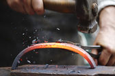 Forging hot iron — Stock Photo
