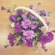 Flower basket on wood top view - Vintage effect style pictures — Stock Photo #66561661