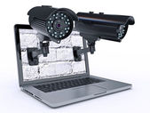 Video surveillance camera and laptop — Stock Photo