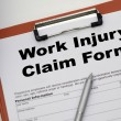Claim form for a work injury on a desk top — Stock Photo #69852823